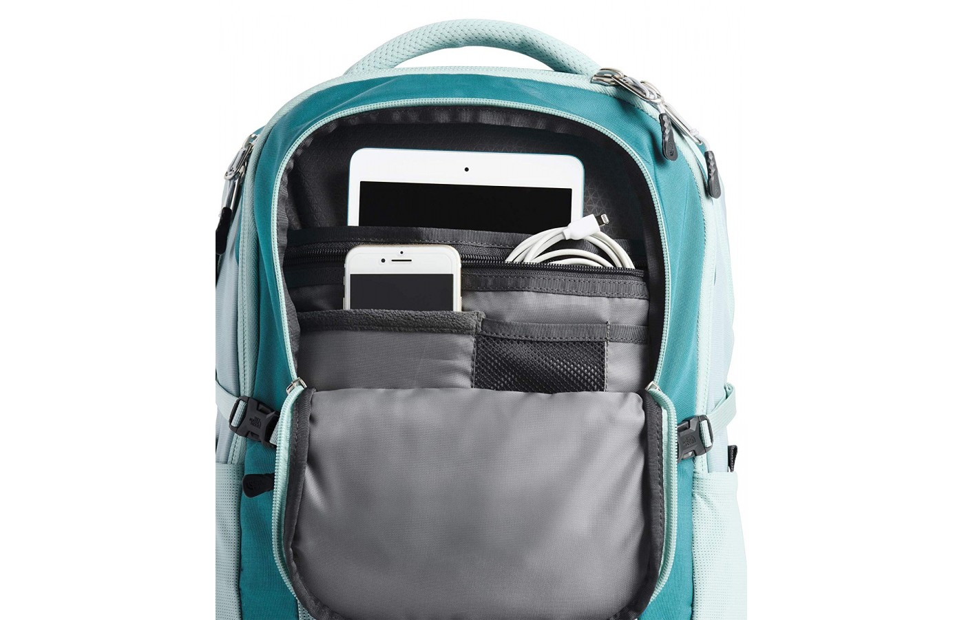 The smaller compartment is a padded fleece lined pocket for an electronic device or small tablet.
