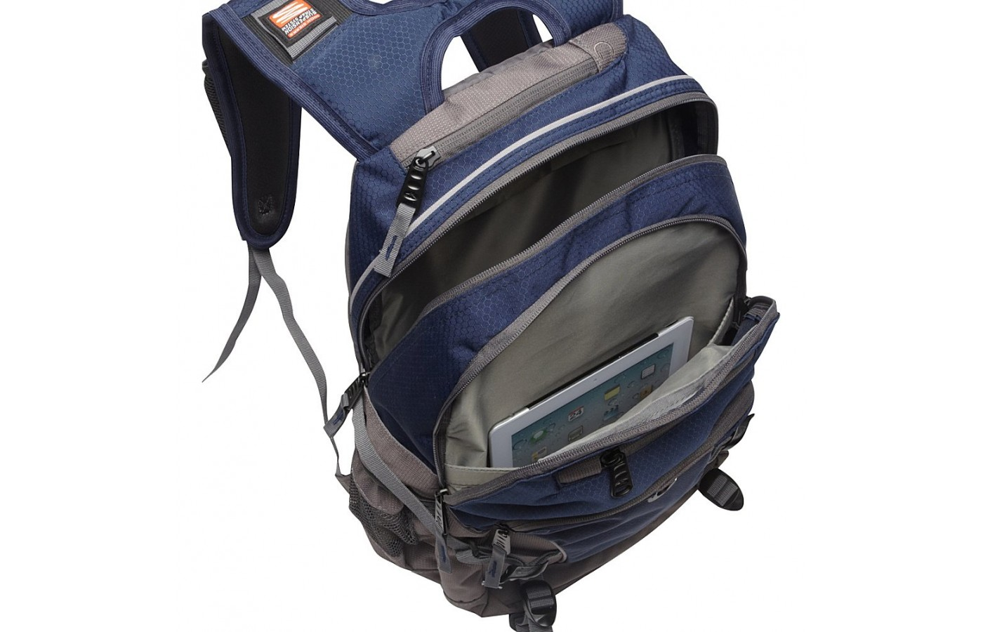 The main compartment can hold a laptop, three-ring binders, textbooks, or a combination of the three.