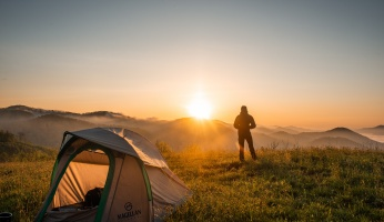 An in-depth guide on the health and social benefits of camping.