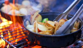 An in-depth look at how to make the most of your campfire cooking.